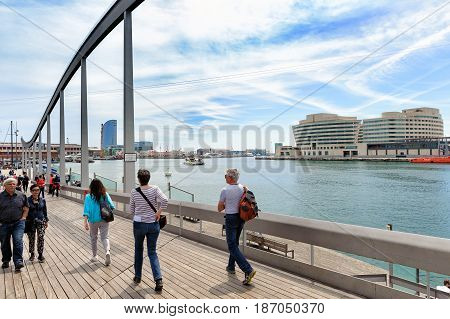 BARCELONA, SPAIN - MAY 2017: People are walking at promenade near sea port of Barcelona town