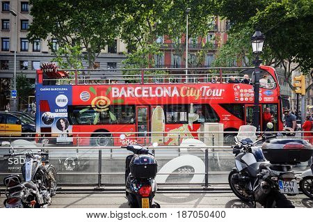 BARCELONA, SPAIN - MAY 2017: City tour excursion bus is staying parked at square   of Catalonia in Barcelona, Spain