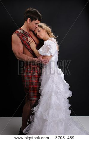the beautiful princess is about to kiss her highlander.