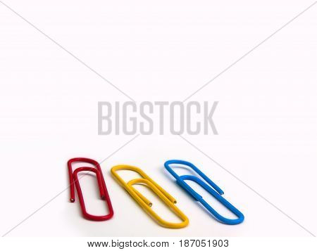 Colorful paper clip on white background.(with free space for text)