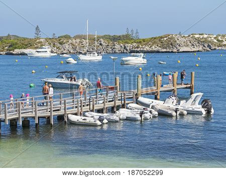ROTTNEST ISLAND WESTERN AUSTRALIA - APRIL 13, 2017: Unidentified holidaymakers on the jetty at at Geordie Bay on Rottnest Island near Perth in Western Australia.