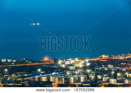 Batumi, Adjara, Georgia - May 27, 2016: Aerial View Of Cityscape At Evening. Black Sea, Port And Fuel Storage In Night Illumination
