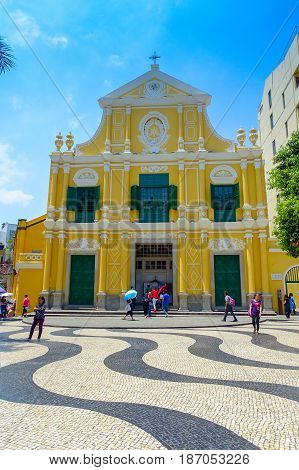 MACAU, CHINA- MAY 11, 2017: An unidentified people walking around of the beautiful St. Dominic Church at Macao. St. Dominic is a medieval church in the old town of Macao.