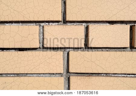 A Wall Of Cracked Bricks With Fresh Cement Joints Closeup