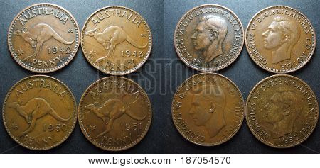Four pre decimal vintage Australian One Penny copper coins. Showing both reverse and obverse sides coins.
