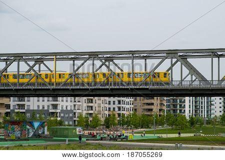Berlin Germany - may 16 2017: Berlin subway train (U-Bahn) outdoors on bridge at Gleisdreieck Park in Berlin.