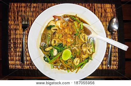 Rice noodles with seafood, sauce and green bean sprouts. Studio Photo