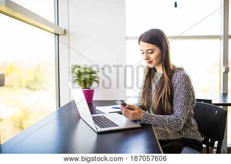 Beautiful Girl Successful Freelancer Using Laptop Computer And Write Text Message On Phone