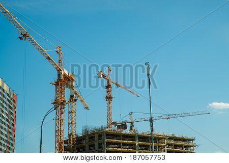Building under construction is a construction crane