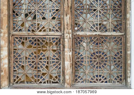 Image Windows, colorful stained-glass Windows with the wrong block, multicolor pattern, round Format. The stained glass pattern in the form of wood and leaves.