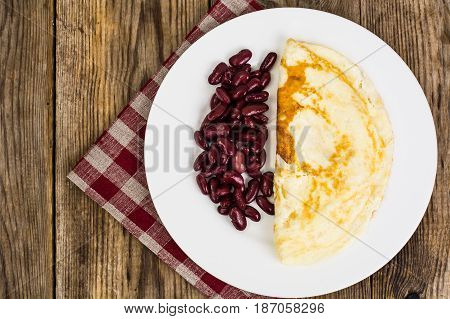 Useful protein breakfast omelet and boiled beans. Studio Photo