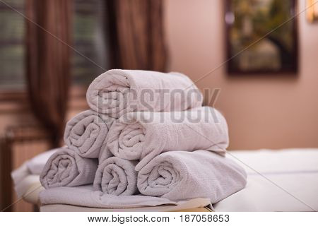 rolls of white towels in spa salon