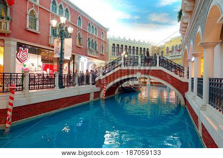 MACAU, CHINA- MAY 11, 2017: An unidentified people walking around inside of a beautiful luxury hotel the Venetian Resort Hotel and Casino.