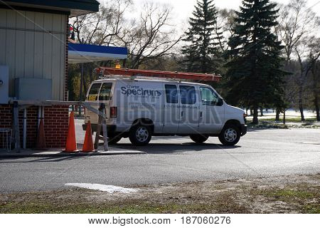 BAY VIEW, MICHIGAN / UNITED STATES - NOVEMBER 26, 2016: A van, belonging to Charter Spectrum, is parked outside the Bay View E-Z Mart.