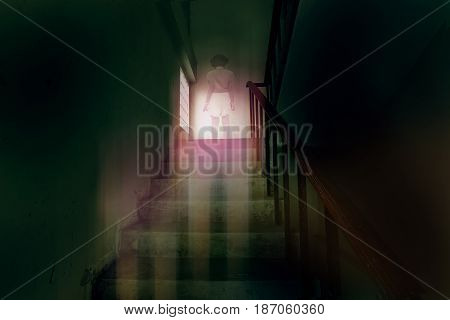 ghost little girl appears on stairs in haunted house child is confined to death.