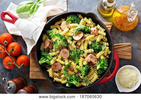 Pasta bake in a cast iron pan with sausage and broccoli