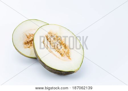 Sliced Santa Claus melon isolated on white background