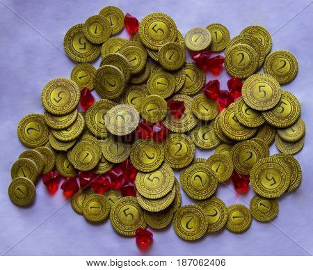 A pile of gold coins and jewels (well, board game piece coins made out of cardboard and rubies made of plastic).