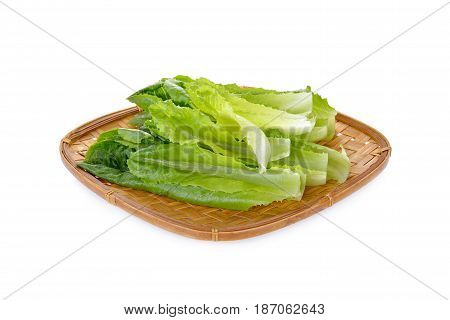 fresh green cos in bamboo tray on white background