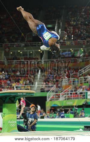RIO DE JANEIRO, BRAZIL - AUGUST 11, 2016: Olympic champion Simone Biles of United States competing a vault at women's all-around gymnastics at Rio 2016 Olympic Games