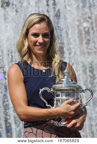 NEW YORK - SEPTEMBER 11, 2016: Two times Grand Slam champion Angelique Kerber of Germany posing with US Open trophy after her victory at US Open 2016 at Billie Jean King National Tennis Center