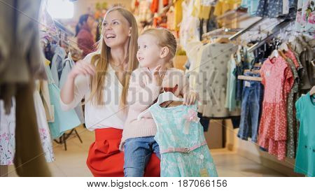 Little girl sitting on my mom's lap and holds the chosen blue dress