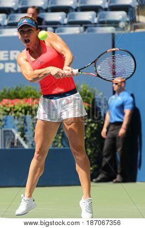 NEW YORK - AUGUST 30, 2016: Professional tennis player Simona Halep of Romania in action during her first round match at US Open 2016 at Billie Jean King National Tennis Center in New York