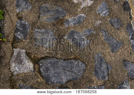 Cement mixed gravel stone floor background top view