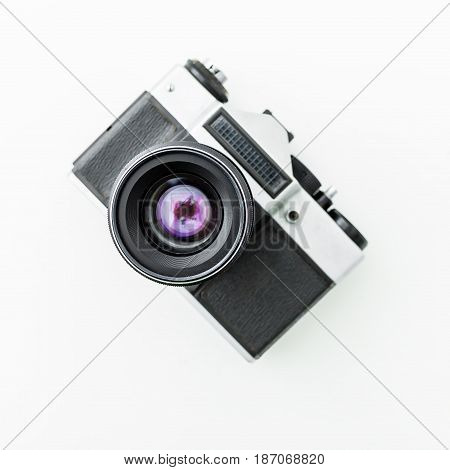 Old retro camera on white. Flat lay, Top view