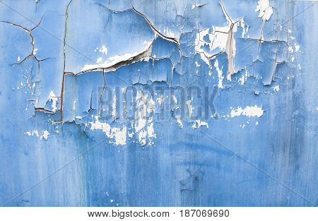 Abstract corroded colorful rusty metal background. Blue paint flaking and cracking texture on rusty metal.Broken color and rusted