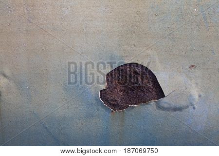 Abstract corroded colorful rusty metal background. Blue paint flaking and cracking texture on rusty metal.broken marble in the dark and warm colors marble background texture closeupBroken color and rusted