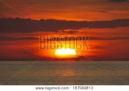 Evening at sea Coast of the sea at colorful sunset Thailand. Beach sunset is a golden sunset sky with a wave rolling to shore as the sun sets over the ocean horizon