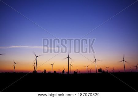 wind turbine sunset background ecosystem vintage. wind turbine silhouette. wind turbine power. wind turbine tower. wind turbine technology.