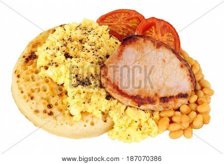 Grilled bacon medallion and scrambled eggs on an English crumpet with baked beans in tomato sauce isolated on a white background