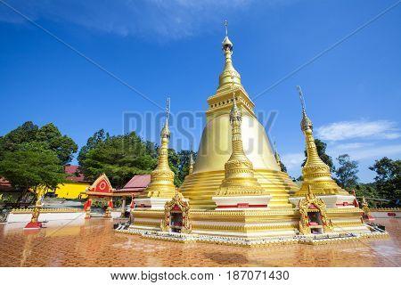 Golden pagoda at Wat Varee Banpot Wat Bang NonRanong Province. Ancient Thai temple golden pagoda