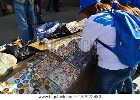 Moscow Russia - may 07.2017. People choose a trade badge of times of the USSR