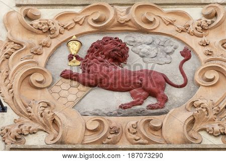 Relief on facade of old building red lion Prague Czech Republic Europe