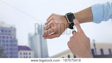 Digital composite of Hands with watch against blurry buildings