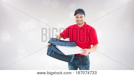 Digital composite of Delivery man removing pizza box from bag
