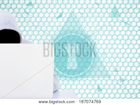 Digital composite of Grey jumper hacker with out face with the computer in the desk. lock