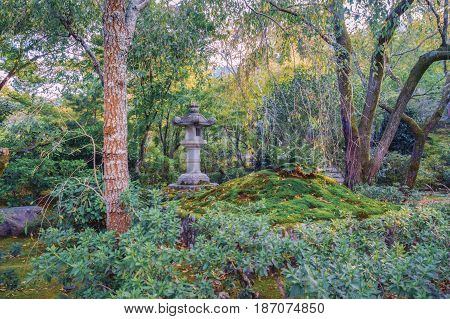 Traditional japanese stone lantern in the park near Kyoto Japan