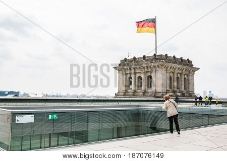 Roof Of The Reichstag And The Flag Of Germany In Berlin In 2017