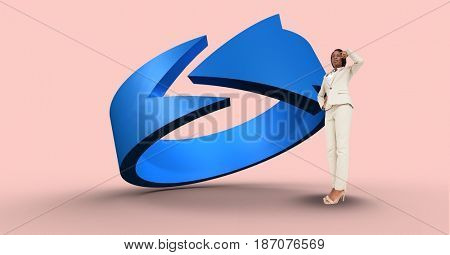 Digital composite of Thoughtful businesswoman by blue arrow sign
