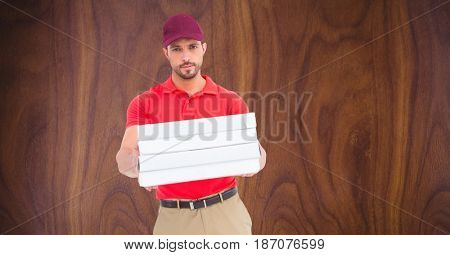 Digital composite of Confident delivery man giving pizza boxes