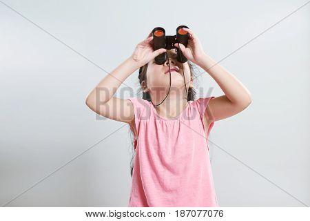 Beautiful little young cute asian girl using telescope .