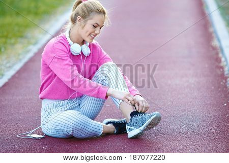 Young Woman Relaxing After Running