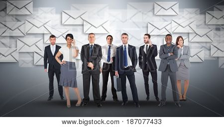 Digital composite of Digital composite image of business people with envelop icons flying in background
