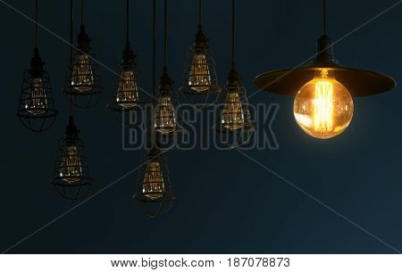 Hanging compose retro light bulb decor glowing in gray background .