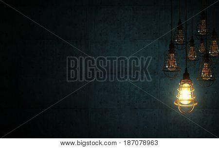 Idea concept with retro light bulbs on the dark blue cement interior background .