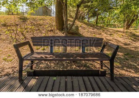 Closeup of a wooden park bench in a public park in South Korea